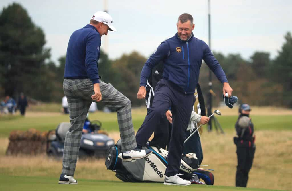 NORTH BERWICK, SCOTLAND - OCTOBER 01: Ian Poulter and Lee Westwood of England do a foot tap as a socially distanced acknowledgement after their first round of the Aberdeen Standard Investments Scottish Open at The Renaissance Club on October 01, 2020 in North Berwick, Scotland. (Photo by Andrew Redington/Getty Images)