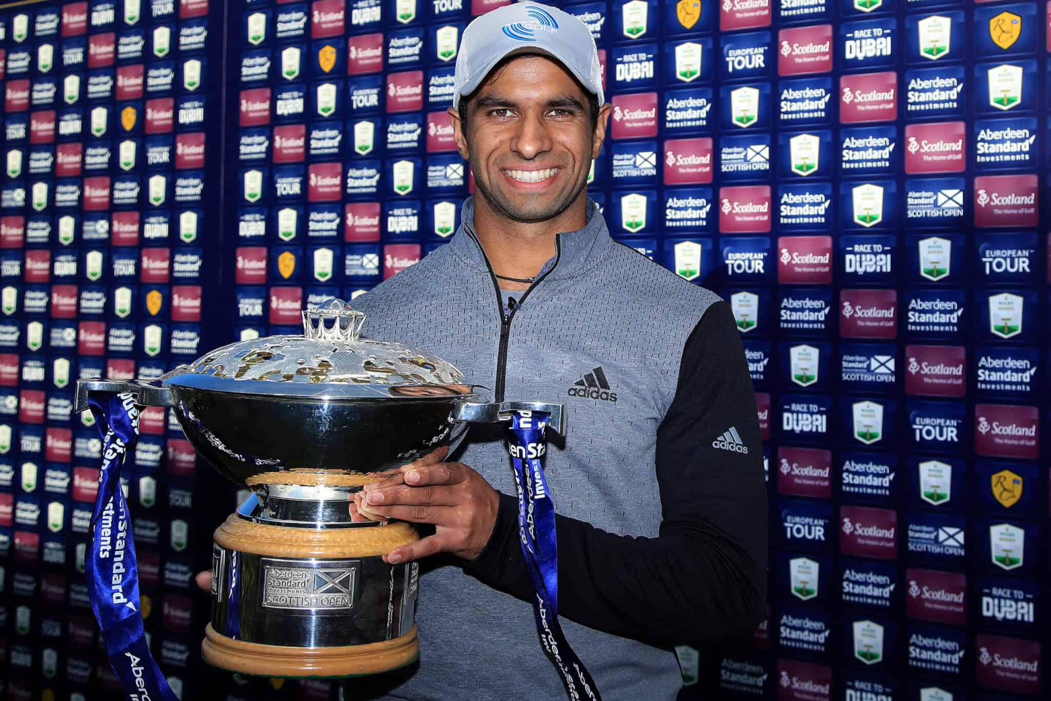 NORTH BERWICK, SCOTLAND - OCTOBER 04: Aaron Rai of England poses with the trophy after beating Tommy Fleetwood of England in a one hole play-off to win the Aberdeen Standard Investments Scottish Open at The Renaissance Club on October 04, 2020 in North Berwick, Scotland. (Photo by Andrew Redington/Getty Images)
